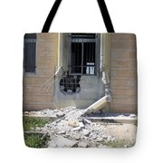 A Rocket Propelled Grenade Damaged This Tote Bag by Stocktrek Images