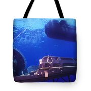 A Seal Delivery Vehicle Hovers Tote Bag by Michael Wood