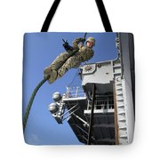 A Soldier Fast-ropes From The Rear Tote Bag by Stocktrek Images