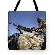 A Soldier Of The British Army Mans Tote Bag by Andrew Chittock