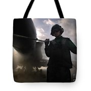 Airman Holds Up The Safety Shot Line Tote Bag by Stocktrek Images