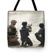 An Afghan Police Student Prepares Tote Bag by Terry Moore