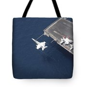 An Fa-18 Hornet Flys Over Aircraft Tote Bag by Stocktrek Images