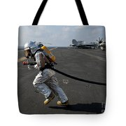 Aviation Boatswain's Mate Carries Tote Bag by Stocktrek Images