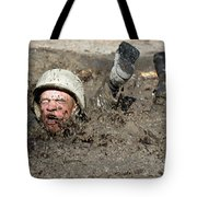 Basic Cadet Trainees Attack The Mud Pit Tote Bag by Stocktrek Images