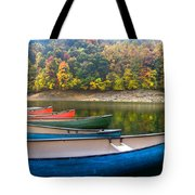 Canoes At Fontana Tote Bag by Debra and Dave Vanderlaan