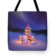 Christmas Tree Glowing Under The Tote Bag by Carson Ganci