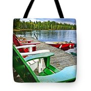 Deck chairs on dock at lake Tote Bag by Elena Elisseeva