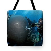 Divers Prepare To Launch A Seal Tote Bag by Stocktrek Images