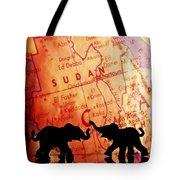 Elephant Silhouettes In Front Of A Map Tote Bag by Chris Knorr