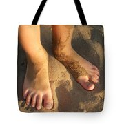 Feet Of A Child In The Sand Tote Bag by Matthias Hauser