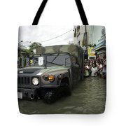 Filipino Citizens Stand In Line Tote Bag by Stocktrek Images