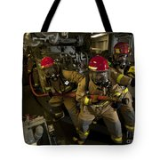 Firemen Combat A Simulated Fire Aboard Tote Bag by Stocktrek Images