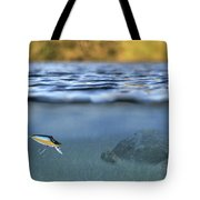 fishing lure in use Tote Bag by Meirion Matthias