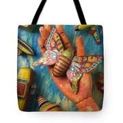 Hand Holding Butterfly Toy Tote Bag by Garry Gay