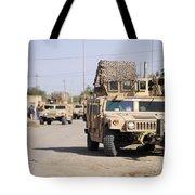 Humvees Conduct Security Tote Bag by Stocktrek Images