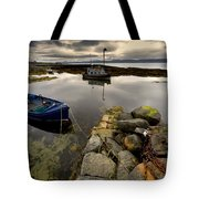 Islay, Scotland Two Boats Anchored By A Tote Bag by John Short