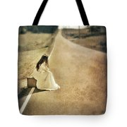 Lady In Gown Sitting By Road On Suitcase Tote Bag by Jill Battaglia