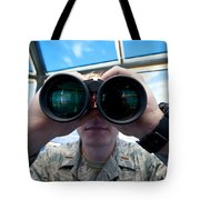 Lieutenant Uses Binoculars To Scan Tote Bag by Stocktrek Images