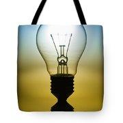 light bulb Tote Bag by Setsiri Silapasuwanchai