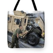 Marine Uses A Pressure Washer To Clean Tote Bag by Stocktrek Images