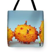 Mountain Climber On Mangosteens II Tote Bag by Paul Ge