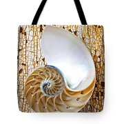 Nautilus Shell On Rusty Table Tote Bag by Garry Gay