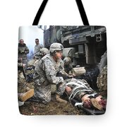 Pararescuemen Prepare To Transport Tote Bag by Stocktrek Images