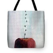 Portrait Of Seven Flies Flying Over An Apple Tote Bag by Fabrizio Cassetta