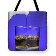 Pouring Oil Into Vinegar Tote Bag by Photo Researchers, Inc.