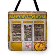 Red Bike At The Boulangerie Tote Bag by Debra and Dave Vanderlaan