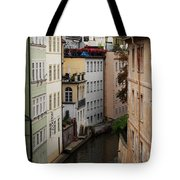 Red Rooftops In Prague Canal Tote Bag by Linda Woods