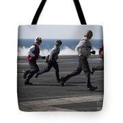 Sailors Clear The Landing Area Tote Bag by Stocktrek Images
