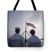 Sailors Stand By To Lower The Ensign Tote Bag by Stocktrek Images