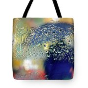 Silhouette In The Rain Tote Bag by Carlos Caetano