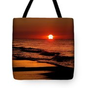 Sun Emerging From The Water Tote Bag by Michael Thomas