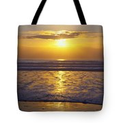 Sunset Over The Pacific Ocean Along The Tote Bag by Craig Tuttle