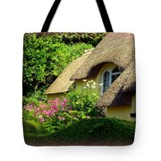 Thatched Cottage With Pink Flowers Tote Bag by Carla Parris