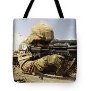 U.s. Air Force Soldier Fires The Mk48 Tote Bag by Stocktrek Images