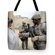 U.s. Army Soldier Shakes Hands With An Tote Bag by Stocktrek Images