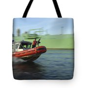 U.s. Coast Guard Officer Mans A M240b Tote Bag by Stocktrek Images