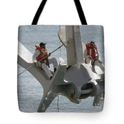 U.s. Navy Servicemen Apply A Coat Tote Bag by Stocktrek Images