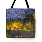 Water Reflections With A Rocky Shoreline Tote Bag by Carson Ganci