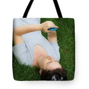 Woman Using Her Iphone Tote Bag by Photo Researchers, Inc.