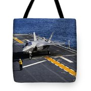 An F-35b Lightning II Makes A Vertical Tote Bag by Stocktrek Images