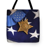 The Medal Of Honor Rests On A Flag Tote Bag by Stocktrek Images