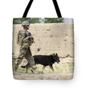 A Dog Handler Of The U.s. Marine Corps Tote Bag by Stocktrek Images