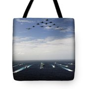 Aircraft Fly Over A Group Of U.s Tote Bag by Stocktrek Images