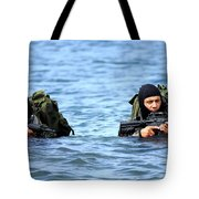 Buds Students Wade Ashore During An Tote Bag by Stocktrek Images