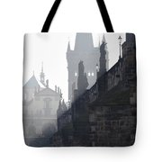 Charles bridge in the early morning fog Tote Bag by Michal Boubin